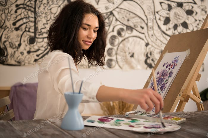 happy and  beatifull female artist drawing the picture