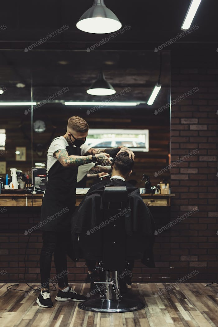 Stylish man working with client in salon