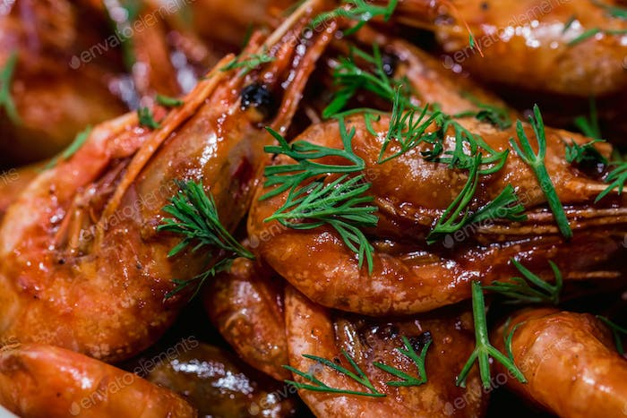 Prepared shrimps with dill close up texture background