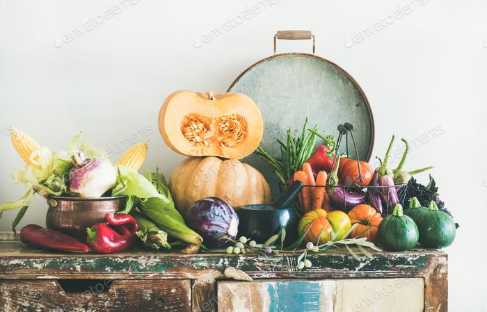 Fall vegetarian food ingredients variety on rustic cupboard