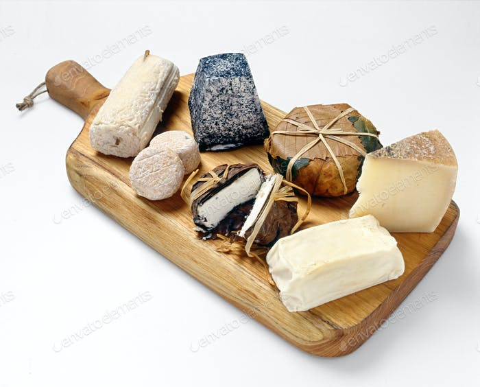 Assortment of cheeses displayed on a cheese board