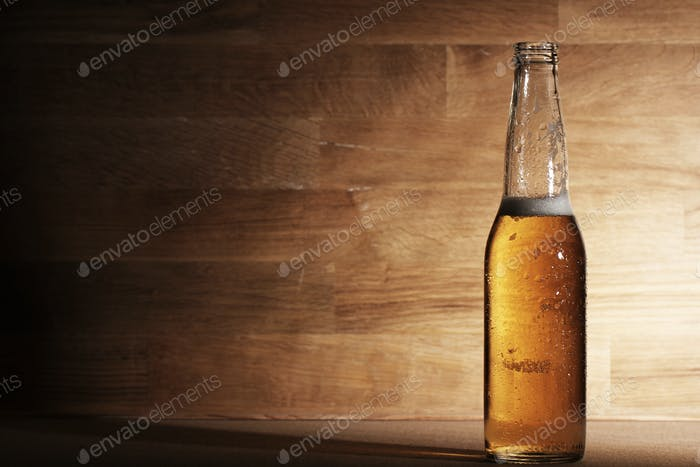 Beer over wooden surface