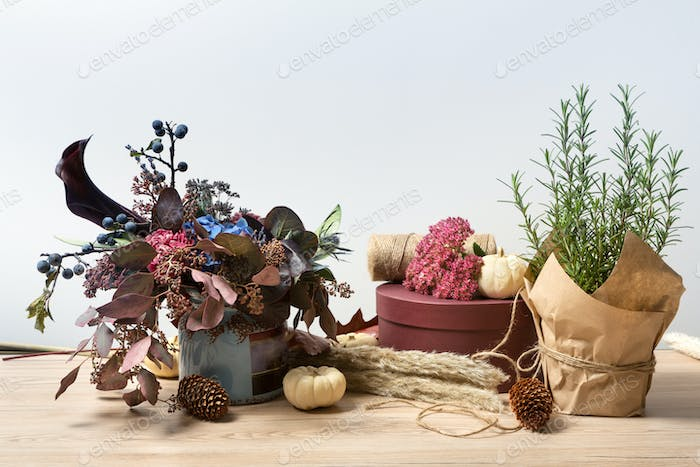 Beautiful autumn composition of dried meadow flowers, rosemary and leaves