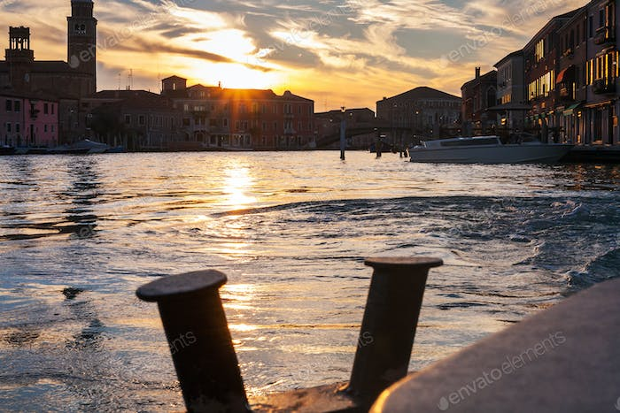 sunset over canal in Venice city