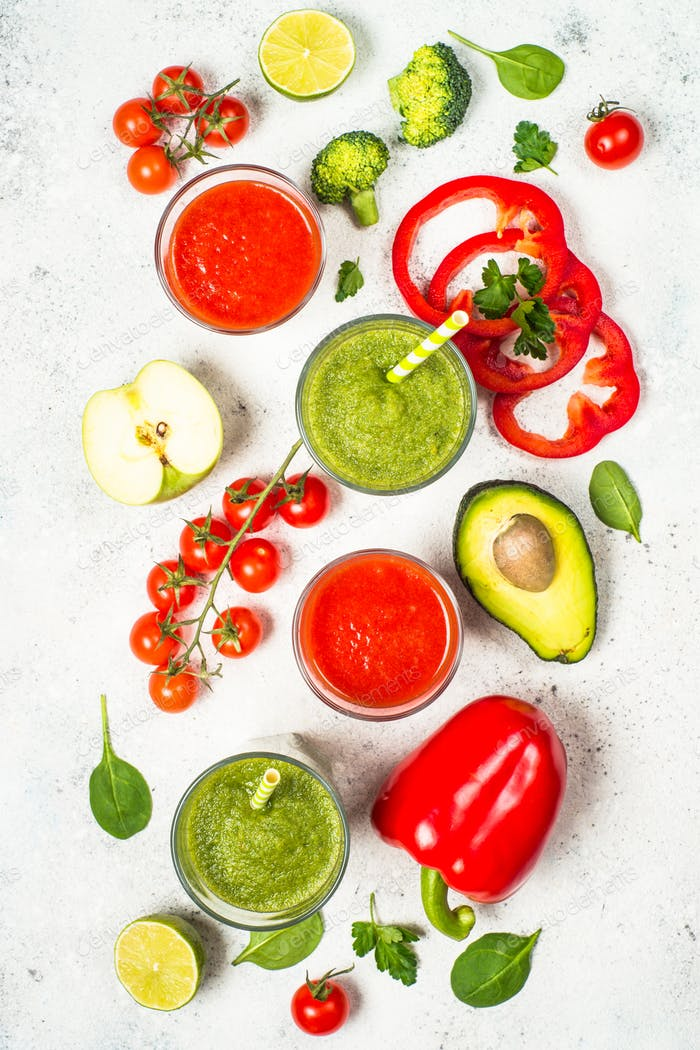 Red and Green vegetable smoothie on white