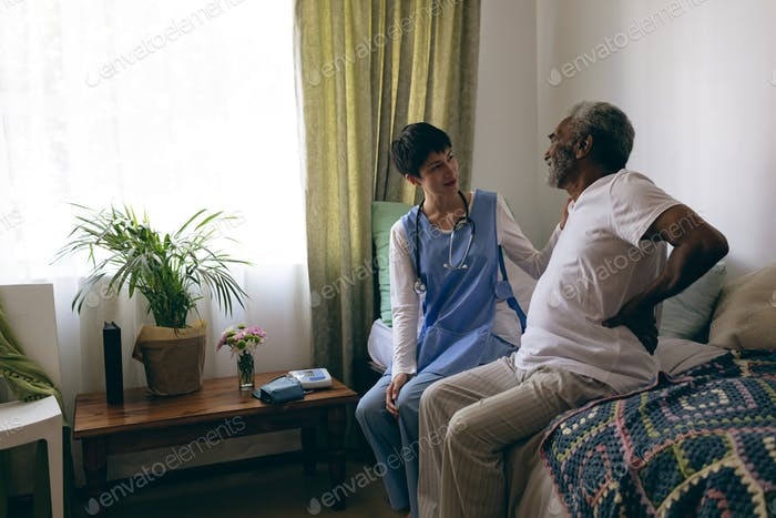 Senior male patient interacting with each other at retirement home