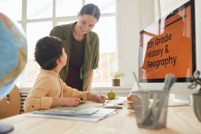 Mother Helping Son in Online Class