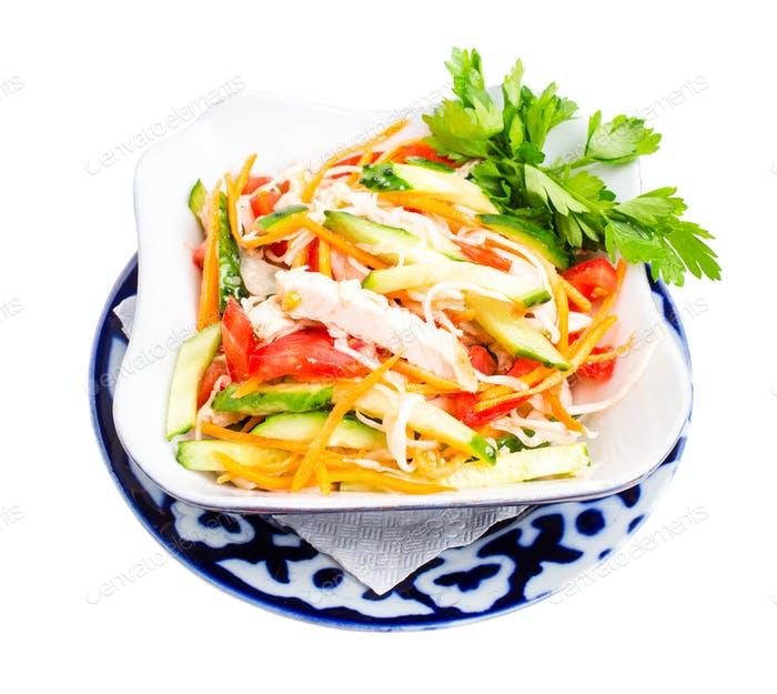 Chinese chicken salad with cucumber and tomatoes.
