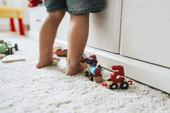 Young kid standing in a playroom