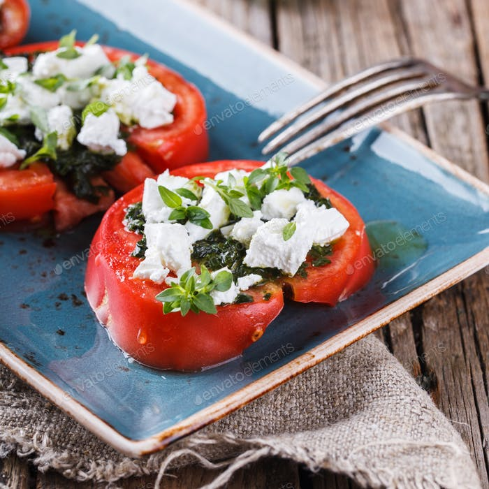 Sliced tomatoes with mozzarella and Basil