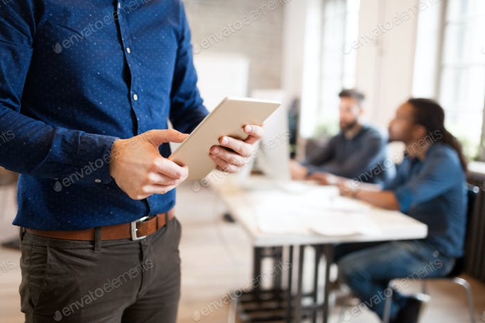 Picture of businessman using digital tablet in office