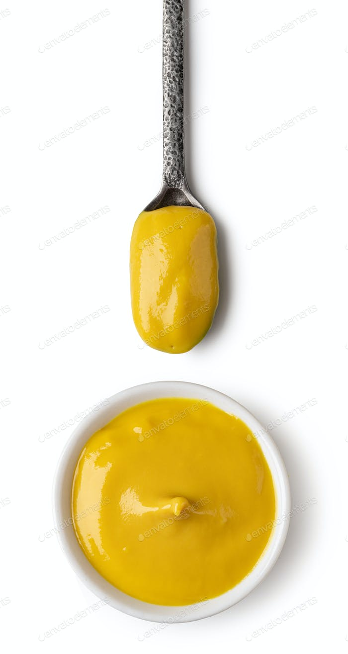 Bowl and spoon with mustard
