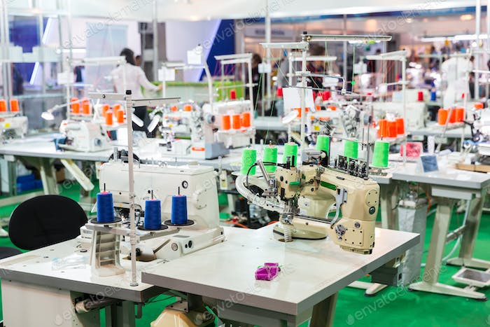 Dressmaker workplace, sewing machines on factory
