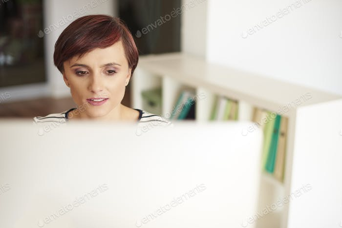 Woman looking at computer screen