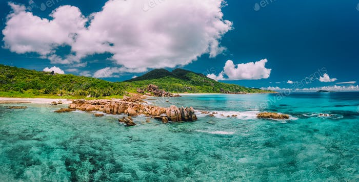Grand Anse beach at La Digue island in Seychelles. Turquoise blue lagoon and exotic tropical island