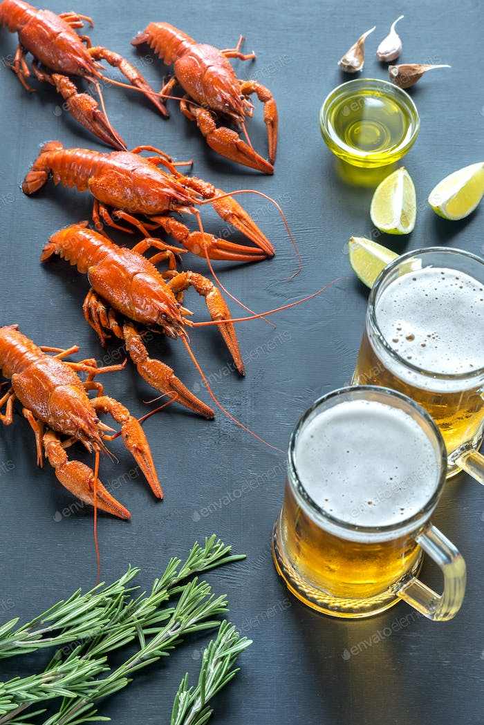 Boiled crayfish with two mugs of beer