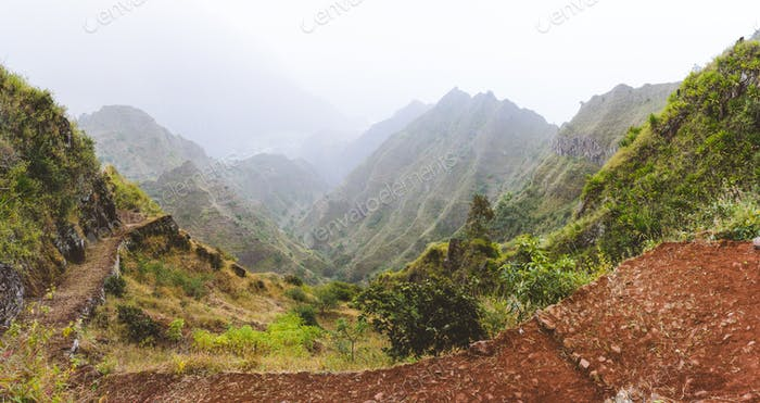 Panoramic view of the fertile ravine valley with volcanic mountain ridges on Santa Antao island in