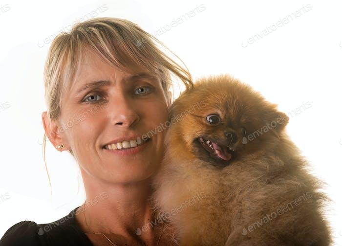 pomeranian dog and woman