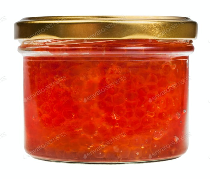 side view of closed glass jar with red caviar