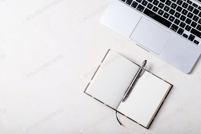 Working place with notepad and pen