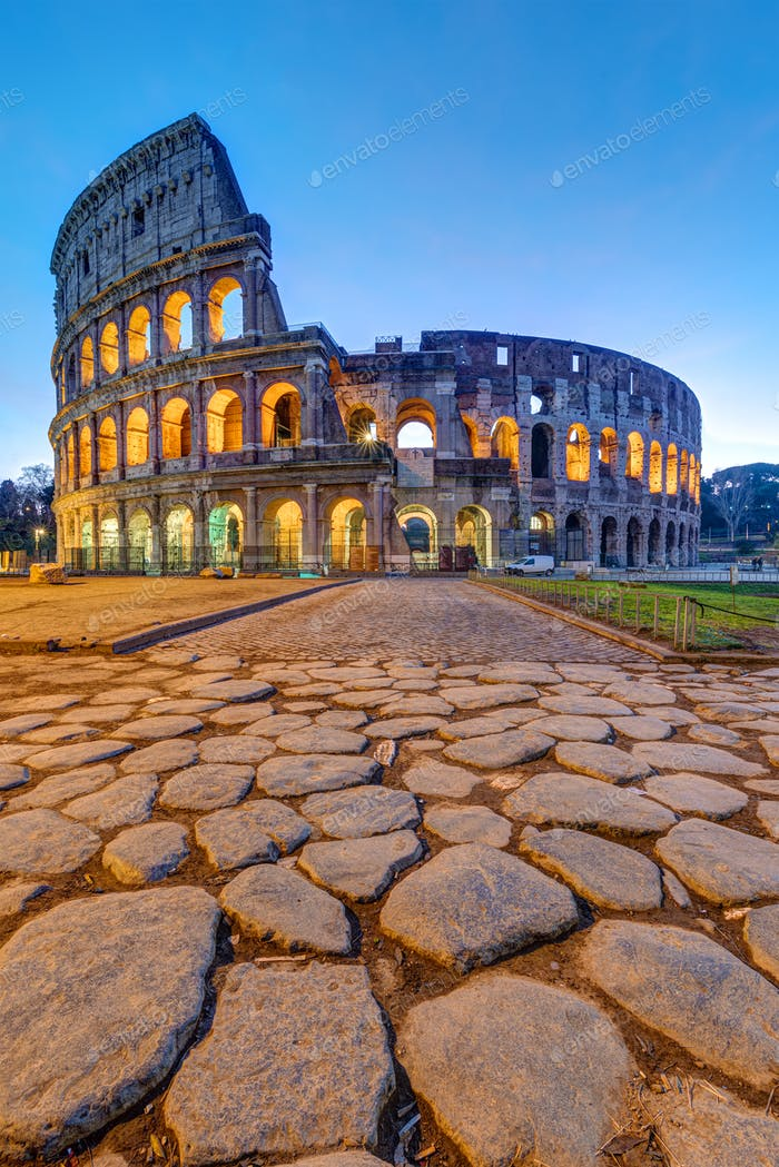 The illuminated Colosseum in Rome at dawn
