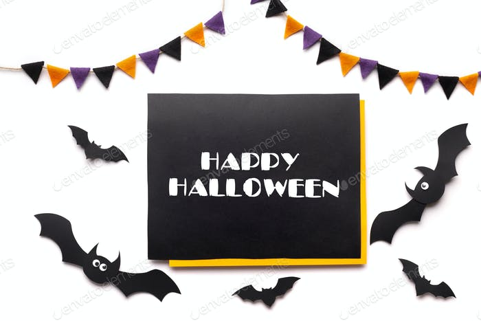 Text on chalkboard with Halloween decorations and bats on white