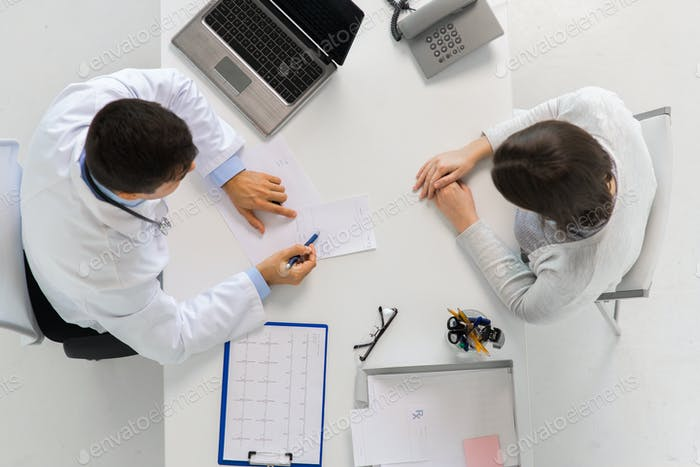 doctor with prescription and patient at hospital