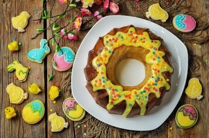 Easter Bundt cake with colorful topping and Easter Cookies