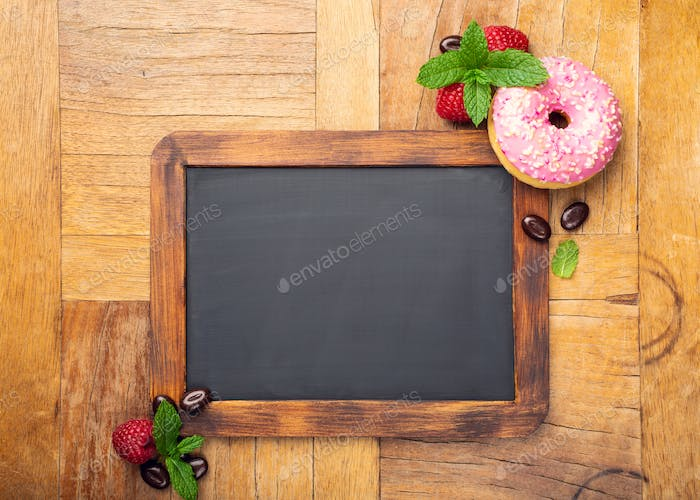 Black chalkboard with pink glazed donut