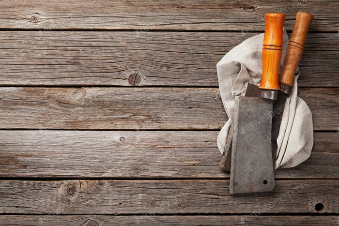 Butcher. Vintage meat knives and kitchen towel
