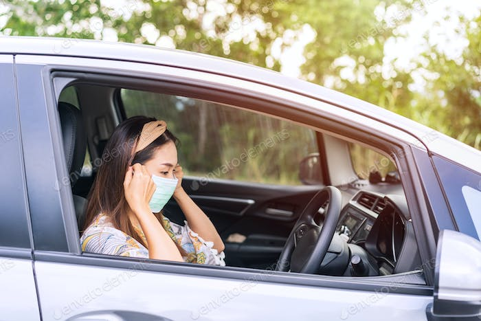 The female driver wearing surgical mask felt confident while traveling