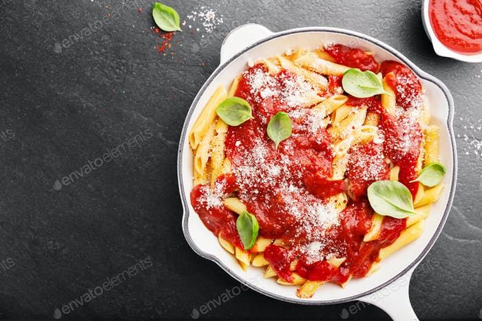 Tomato italian penne pasta served in pan