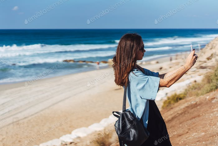 Thumbnail for Young woman take a photo on smartphone