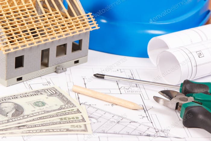 Electrical construction drawings, work tools and accessories, small toy house and currencies dollar
