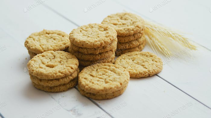 Healthy oatmeal cookies on white wood background, Side view