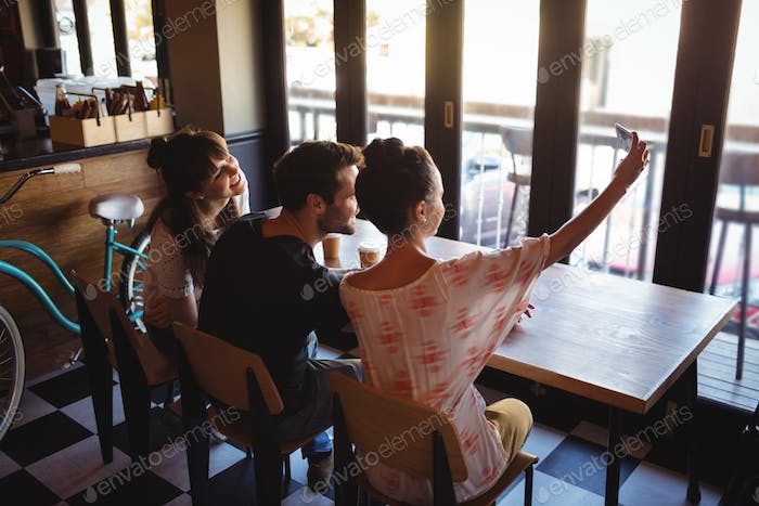 Friends taking a selfie on mobile phone