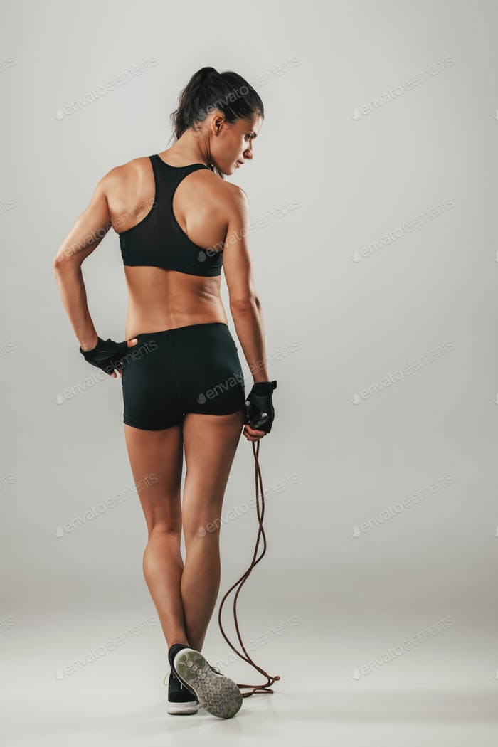Fit healthy athletic woman with a skipping rope