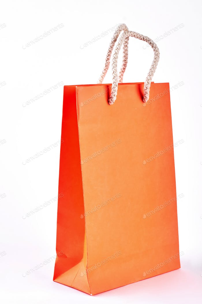 Paper shopping packet on white background