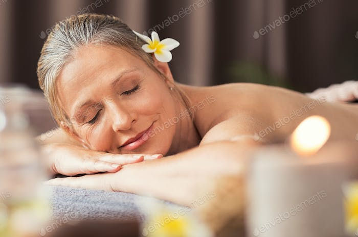 Senior woman relaxing at spa