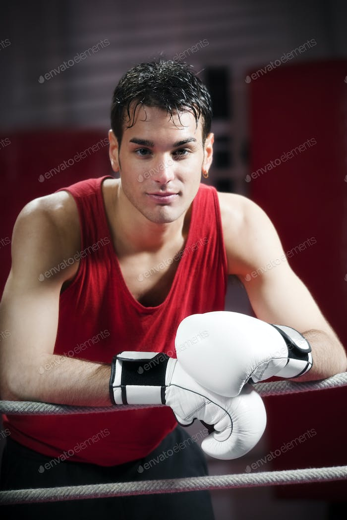 Portrait Of Man Boxer Athlete Standing In Boxing Gym