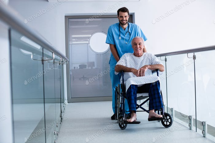 Doctor pushing a patient on wheelchair