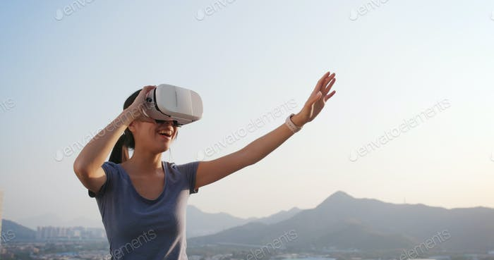 Woman watching with virtual reality in city