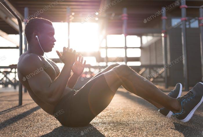 Strong black man doing abdominal exercises