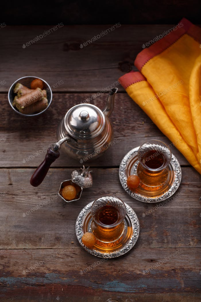 Top view of turkish tea with turkish sweets, copy space