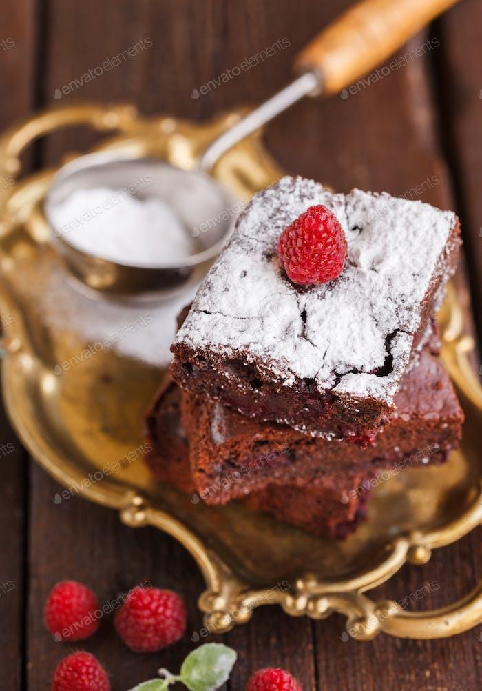 Chocolate brownie with raspberries.