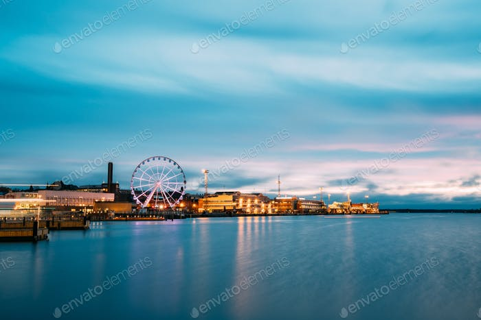 Helsinki, Finland. View Of Embankment With Ferris Wheel In Eveni
