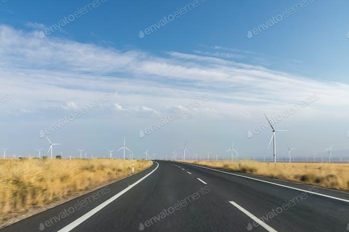 curve road motion blur through the wind farm