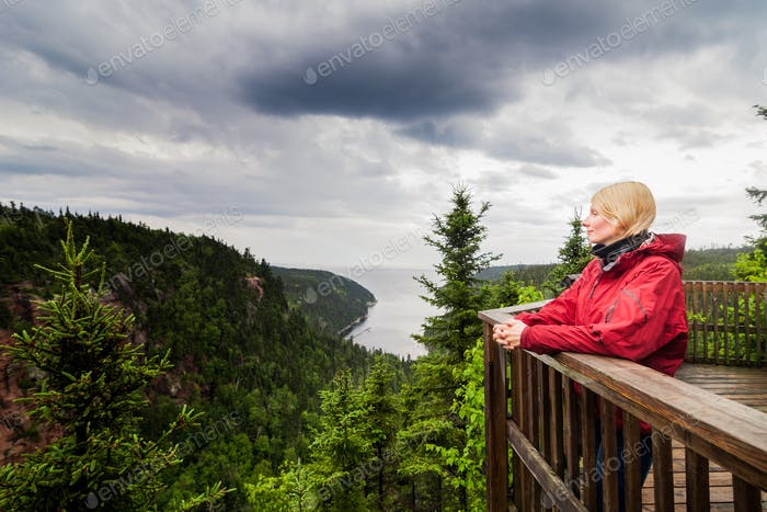 Young Woman Looking at the Amazing Nature from an Observation To
