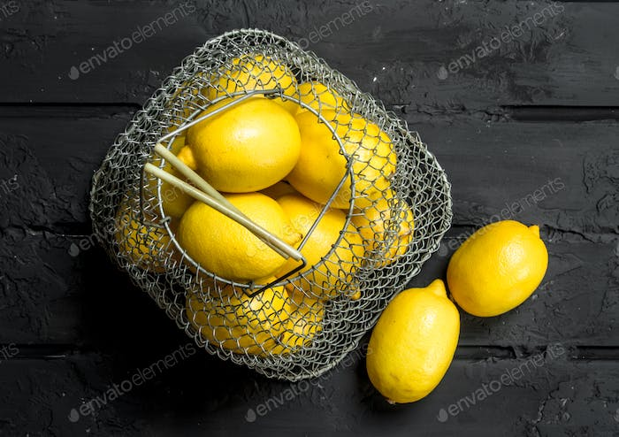 Fresh lemons in the iron basket.