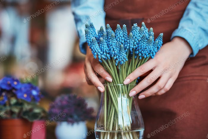 Young florist with muscari